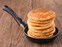 Frying pan with pancakes Stock Photography