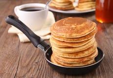 Frying pan with pancakes Stock Image
