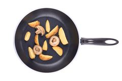 Frying pan with potatoes and mushrooms. Royalty Free Stock Photo