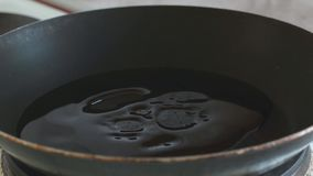 In a frying pan pour vegetable oil. Cooking stock video