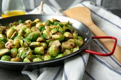 Frying pan with roasted brussel sprouts. On table royalty free stock photos