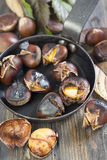 Frying pan with roasted chestnuts closeup. Stock Images