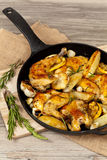 Frying Pan with Roasted chicken Stock Image