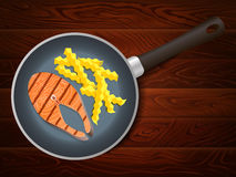 Frying pan salmon french fry wooden table Stock Photo
