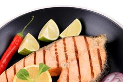 Frying pan with salmon steak. Stock Photo