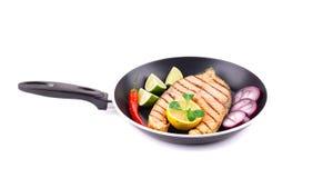 Frying pan with salmon steak Royalty Free Stock Photos
