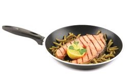 Frying pan with salmon steak. Royalty Free Stock Photo
