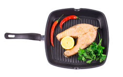 Frying pan with salmon Royalty Free Stock Photography