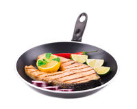 Frying pan with salmon steak. Stock Photos