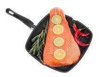 Frying pan with salmon steak. Royalty Free Stock Photos