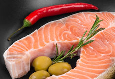Frying pan with salmon steak. Royalty Free Stock Image