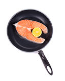 Frying pan with salmon steak Royalty Free Stock Photography