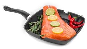 Frying pan with salmon steak. Royalty Free Stock Photo