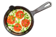 Frying pan with scrambled eggs and tomatoes Stock Photo