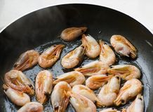 Frying pan with sea food. Shrimp Stock Image
