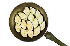 Frying pan with slices of fresh eggplant isolated on white Stock Photography
