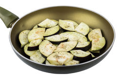 Frying pan with slices of fresh eggplant on white Royalty Free Stock Images