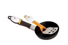 Frying pan and spatula Stock Image