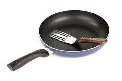Frying pan and spatula Stock Photography
