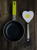 Frying pan with a spatula in the form of heart stock photo