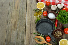 Frying pan, spices and seasonings Stock Image