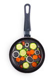 Frying pan with vegetables Stock Photography