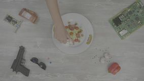 Frying pan with vegetables on the table. various kitchen utensils on wooden table background. Ingredients for cooking. Baking ingredients, top view 4K stock footage