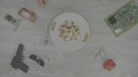 Frying pan with vegetables on the table. various kitchen utensils on wooden table background. Ingredients for cooking. Baking ingredients, top view 4K stock video footage