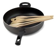 Frying pan with wooden spoon Stock Images