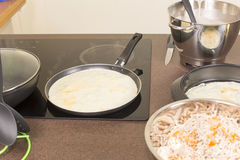 Frying of pancakes Stock Photos