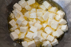 Frying paneer in ghee Royalty Free Stock Photos