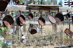 Frying pans on a fence stock photography