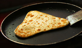 Frying paratha in refined oil Stock Photos
