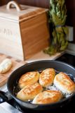 Frying pies in the kitchen stock photography