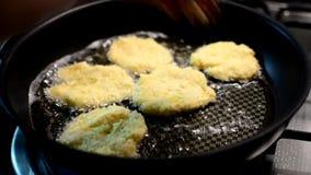 Frying potato pancakes stock video footage