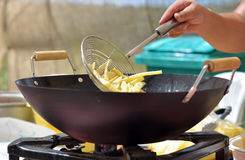 Frying potatoes Stock Image