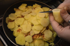 Frying potatoes. With cpises and onion Stock Photography