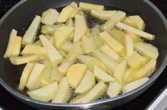 Frying potatoes royalty free stock photos