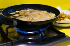 Frying potatoes for a potato omelet royalty free stock image