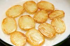 Frying potatoes. Royalty Free Stock Images