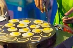 Frying quail eggs Stock Photos