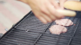 Frying Raw Meat for Burgers then Buns on the Grill stock footage