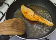 Frying Salmon in non stick pan Royalty Free Stock Photos