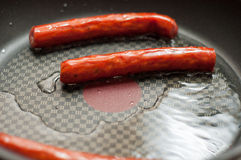 Frying sausages Royalty Free Stock Photography