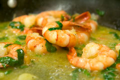 Frying shrimps. Shrimps are fried in butter Royalty Free Stock Photo