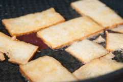Frying tofu slices Stock Photo
