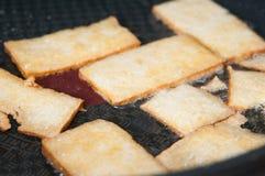 Frying tofu slices Stock Photo