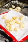 Frying torta frita in a steel basket Stock Photos