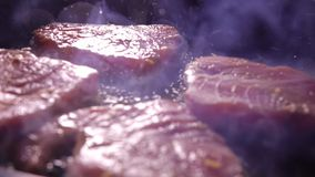 Frying tuna fillet in sizzling oil. Slow motion close-up shot. Frying tuna fillet in sizzling oil. Slow motion close-up video stock video footage