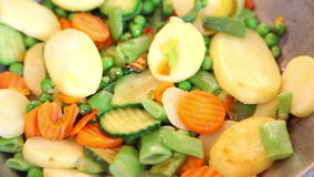 Frying vegetable mix stock video footage